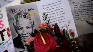 Cards and flowers are left outside the Medi-Clinic Heart Hospital, where the ailing former South African President Mandela is being treated, in Pretoria